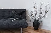picture of futon  - Gray sofa winter decorations and cozy lights in the living room - JPG