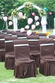 pic of lawn chair  - Group of chairs and balloons for wedding on the lawn