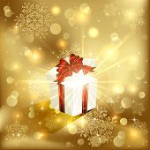 Gift box on golden background