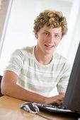 Teenage Boy Using Desktop Computer