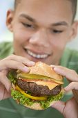 Teenage Boy Eating Burger