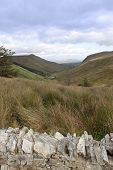 picture of long winding road  - view of long grass and winding road with green mountains in county Donegal Ireland - JPG