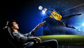picture of boys night out  - Young man watching football match on TV - JPG