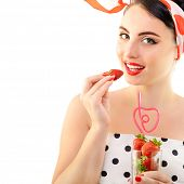 Beautiful pinup with strawberries, portrait of young happy smiling sexy woman in pin-up style, over