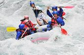 foto of raft  - Rafting as extreme and fun team sport - JPG