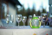 Baby Bottle Among Adult Glasses