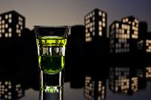 Absinthe shot in nice  cityscape setting