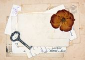 Old Letters, Empty Post Cards And Dried Rose