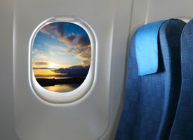 stock photo of cabin crew  - Airplane seat and window inside an aircraft - JPG
