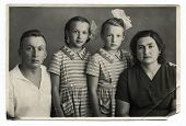 MOSCOW, USSR - CIRCA 1950s : An antique photo shows family portrait: mother, father and their two daughters - twins.