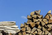 Logs Of And Boards Of Wood Of Different Shapes, Sizes And Kinds Piled Together In Saw-mill