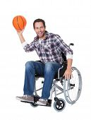image of paralympics  - Man in wheelchair with basketball - JPG