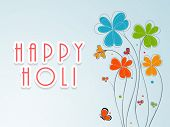 Indian festival Happy Holi celebration concept with stylish text on beautiful flowers decorated background.