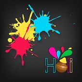Indian festival Happy Holi celebration concept with stylish text on colours splash background.