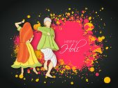 Beautiful Indian colours festival Holi concept with young couple in traditional outfits dancing and