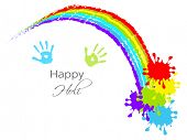 Indian festival Happy Holi celebrations concept with colours splash and hand prints impression on grey background.