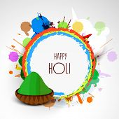 Indian festival Happy Holi celebrations concept with colours and wishes.