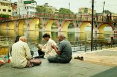 UDAIPUR - SEPT 20 2012:  Four man playing cards on the side of the Pichola lake at Udaipur also call