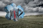 Back injury diagram on abstract screen against stormy countryside background