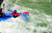stock photo of rafters  - Two rafters ride the rapids in rio pejibaye Costa Rica - JPG