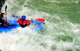 pic of rafters  - Two rafters ride the rapids in rio pejibaye Costa Rica - JPG