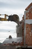 Mechanical Digger Demolishing A Building