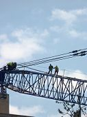 Construction workers on crane