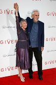 NEW YORK-AUG 11: Director Phillip Noyce (R) and author Lois Lowry attend the premiere of