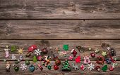 Wooden Xmas Or Christmas Background With Colorful Decoration.