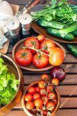 Homegrown Vegetables In Wooden Dishware For Spring Picnic.
