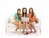 Young women on sofa with laptop