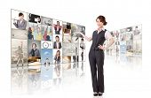 Business woman introduce and standing in front of TV screen wall.