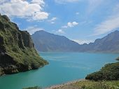 stock photo of luzon  - A gorgeous view of the crater and lake left behind by the violent eruption of Mt - JPG