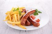 grilled sausage and fries