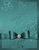 teal embossed paper with bow and diamonds