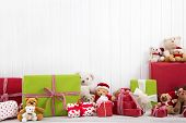 Red And Green Christmas Presents With Teddy Bears On White Background