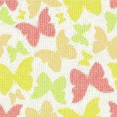 Seamless pattern with textile butterflies. Knitted texture