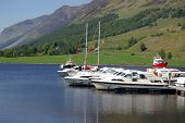 Boats On The Dock On The Lake, Scotland, Uk