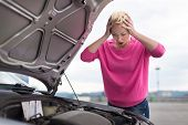 Stressed Young Woman with Car Defect.