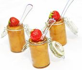 Three glasses of apple compote with strawberry decoration
