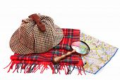 stock photo of glass-wool  - Deerhunter cap vintage magnifying glass tartan scarves and London map Isolated on white - JPG
