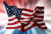 American flag in front of red, white and blue  background