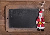 Chalk Board For Merry Christmas Message , Santa On Wooden Background For A Greeting Card