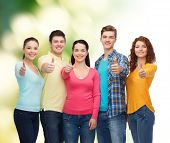 friendship, ecology, gesture and people concept - group of smiling teenagers showing thumbs up over