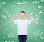 childhood, gesture, education, advertisement and people concept - smiling boy in white t-shirt with