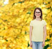 education, school and vision concept - smiling cute little girl in black eyeglasses