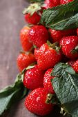 Ripe sweet strawberries  on color wooden background