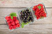 Fresh ripe berries on wooden table background