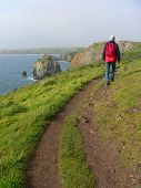 Man Walking On A Coastal Hiking Path, South England
