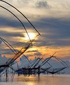 landscape of square dip nets at sunrise
